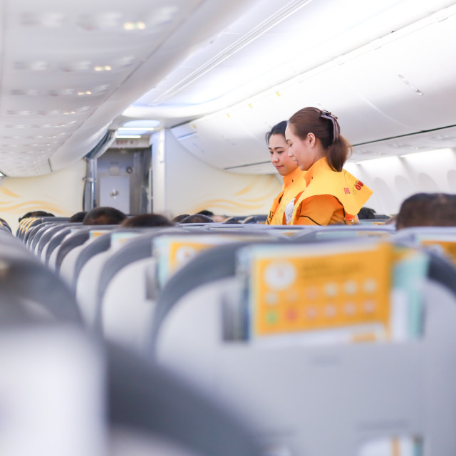 """Air hostess demonstrate safety procedures to passengers"" stock image"