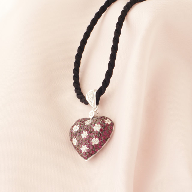 """White Gold Heart Shaped Pendant With Rubies And Diamonds"" stock image"