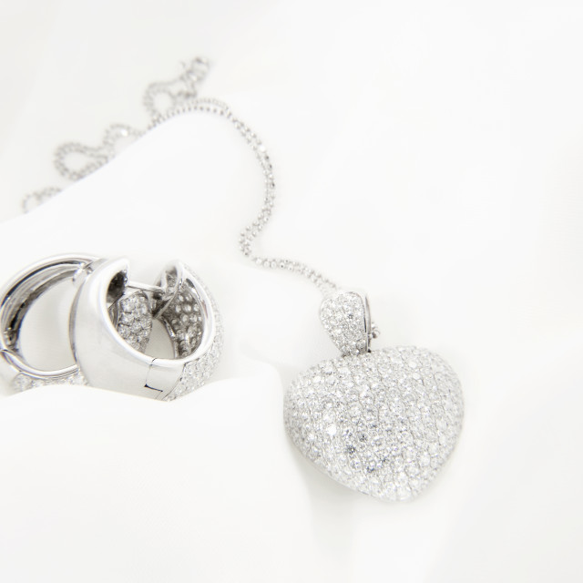 """White Gold Earrings And Heart Shaped Pendant With Diamonds"" stock image"