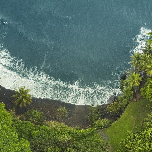 """Aerial View Of A Secluded Black Sand Beach In Hawaii"" stock image"