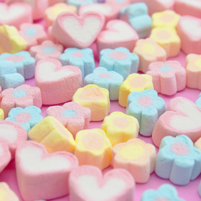 """Selective focus colorful fluffy marshmallows on pink background, sweet dessert fudge"" stock image"