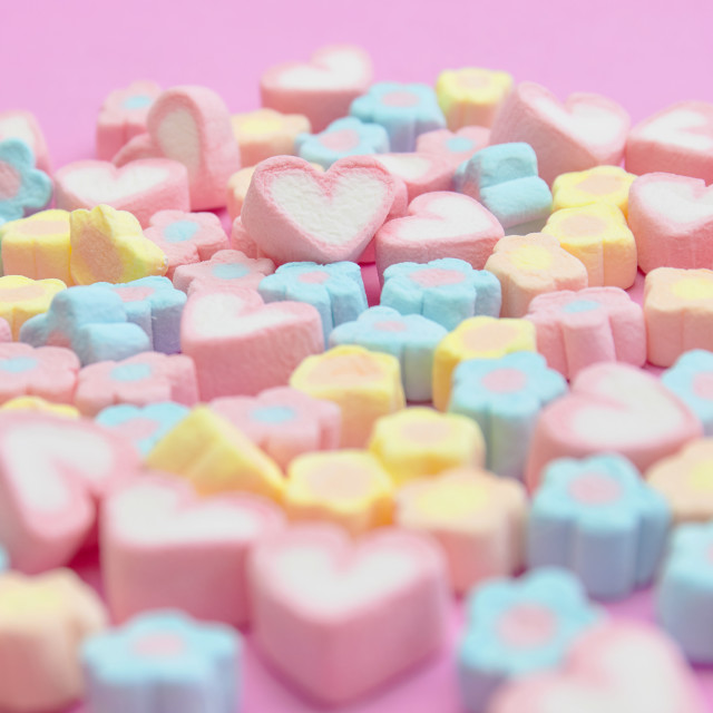 """Closeup with selective focus colorful fluffy marshmallows on pink background"" stock image"