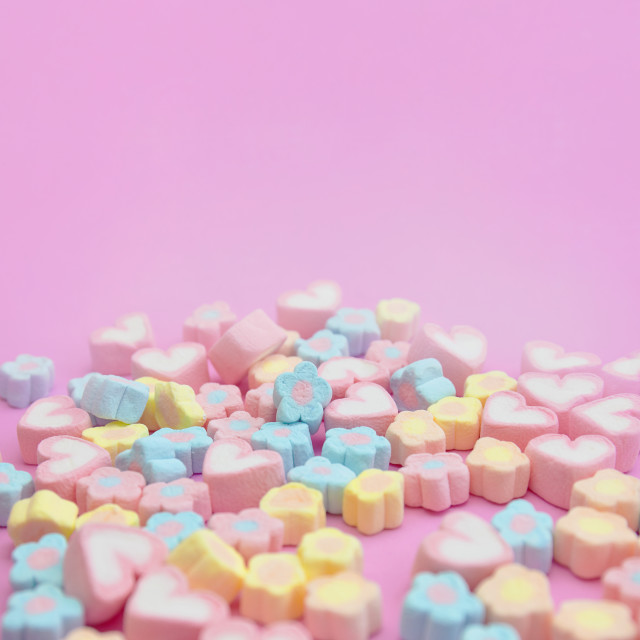 """Close-up colorful pastel sweet color of marshmallows on pink background with copy space"" stock image"