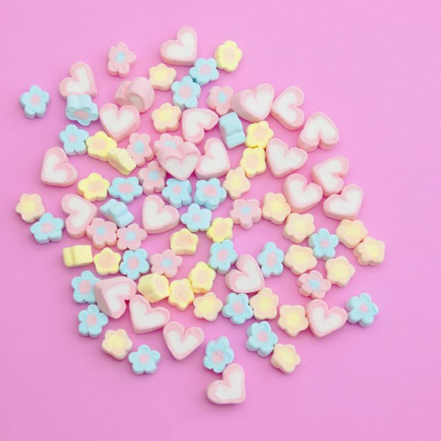 """Flatlay colorful marshmallows on sweet pink background with copy space"" stock image"