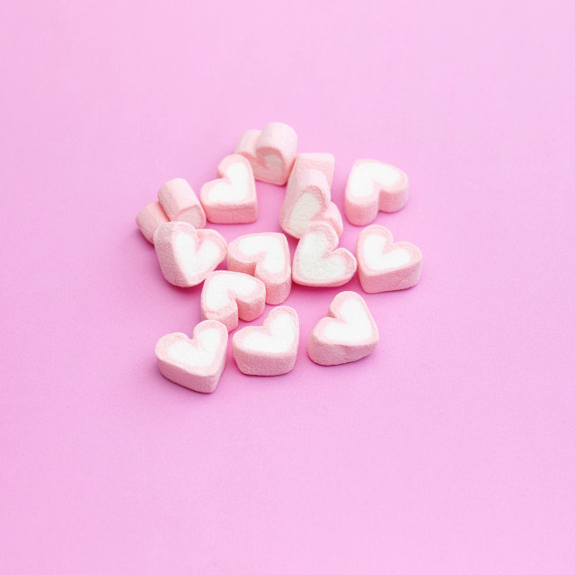 """Top view flat lay design of pastel pink color marshmallows on pink background with copy space"" stock image"