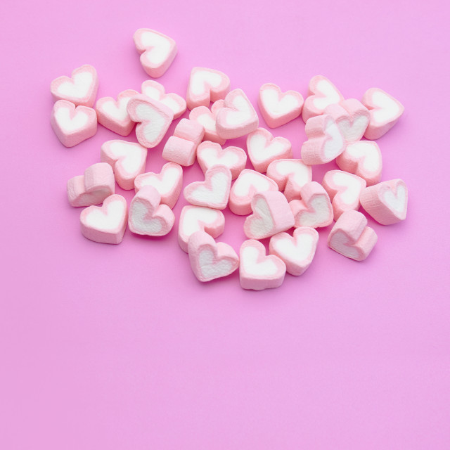 """Top view, Flatlay template design of candy color marshmallows on pink background with copy space"" stock image"