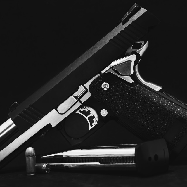 """""""Carbon-based airsoft guns on the black background.Black and whit"""" stock image"""
