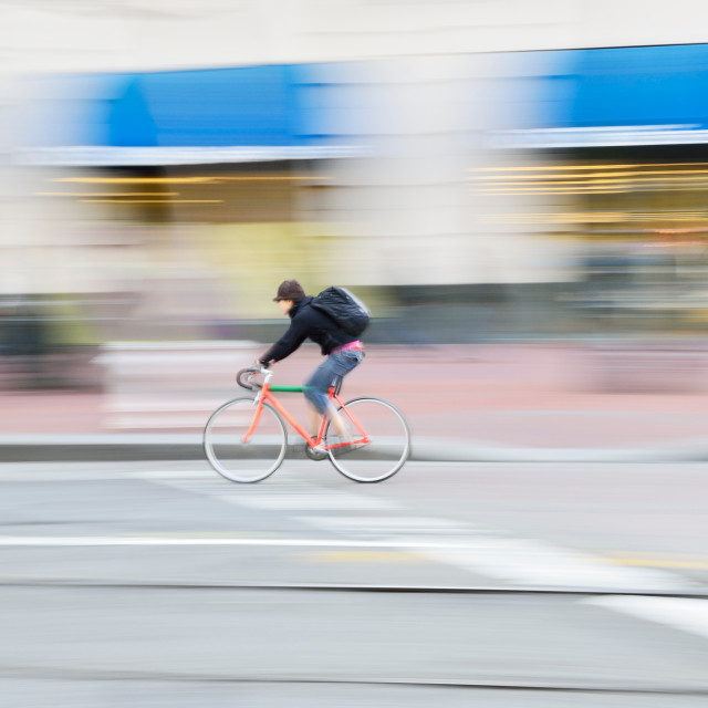 """""""Urban cyclist riding at speed"""" stock image"""