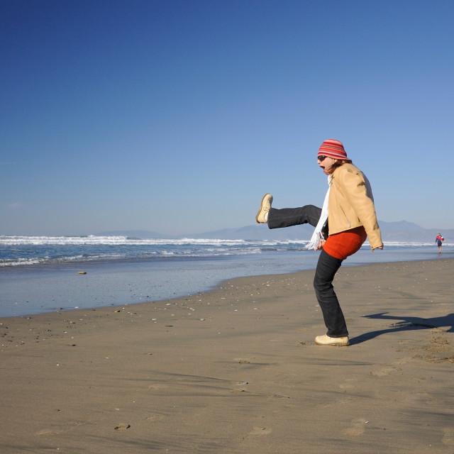 """Woman having fun at the beach"" stock image"