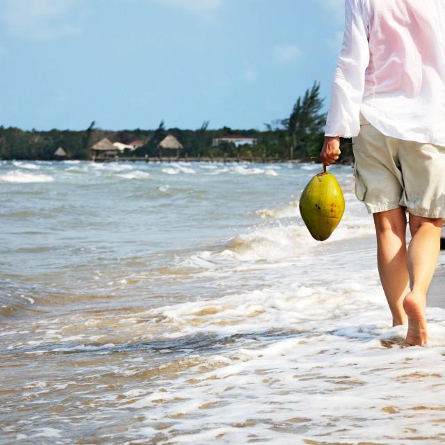 """Walking along the beach"" stock image"