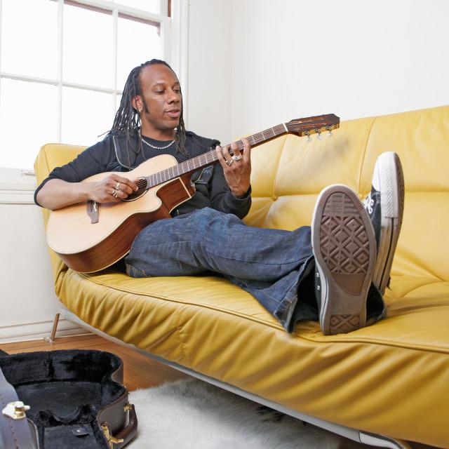 """""""Man playing guitar"""" stock image"""