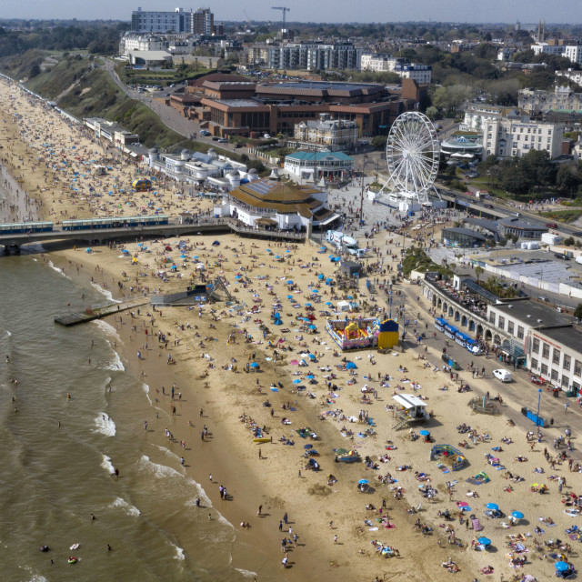 """Beach goers pack out Bournmouth Beach today, Good Friday as Britian basks in temperatures of 23oC. The warm weather is expected to last for the entire easter weekend. 19th April 2019"" stock image"