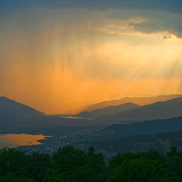 """Golden sunset and summer rain"" stock image"