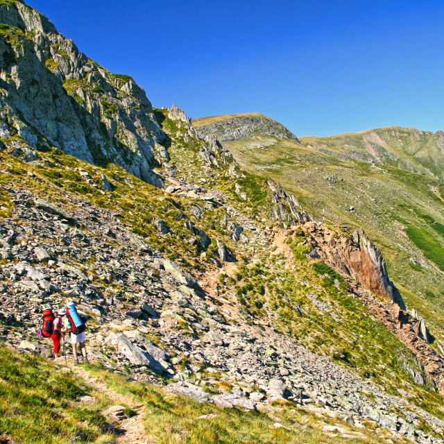 """Summer mountain scene, hiking tourists on trail."" stock image"