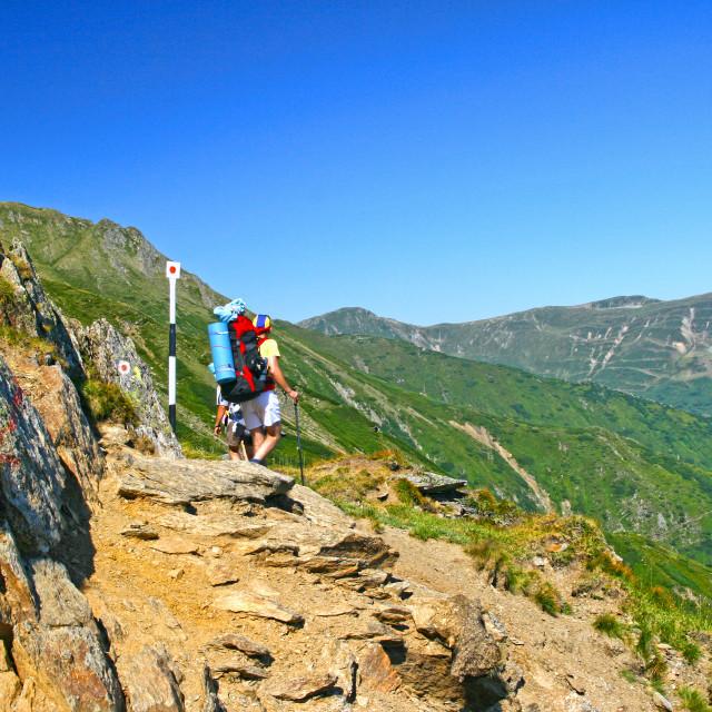 """Hiking teens on mountain trail"" stock image"