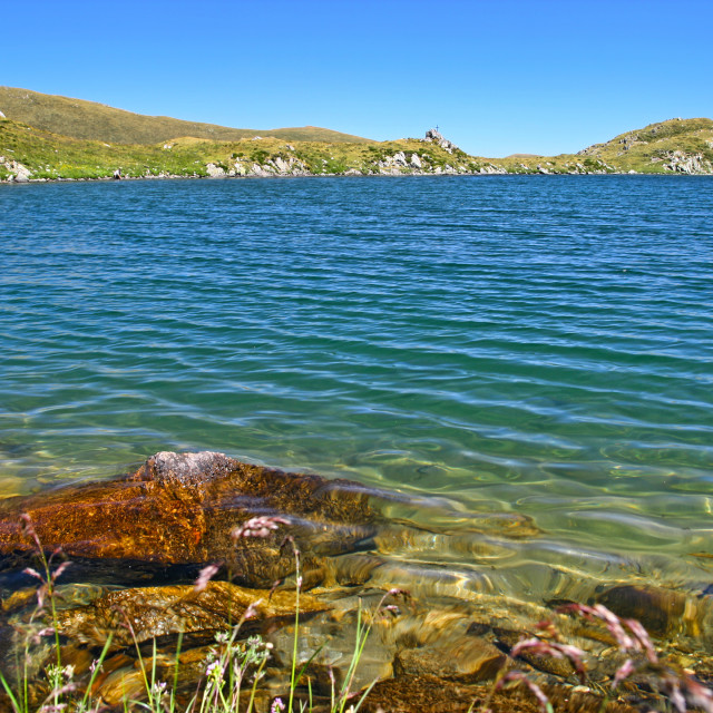 """""""Clear summer lake in the mountains"""" stock image"""
