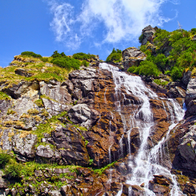 """""""Rocky waterfall in summer mountain"""" stock image"""
