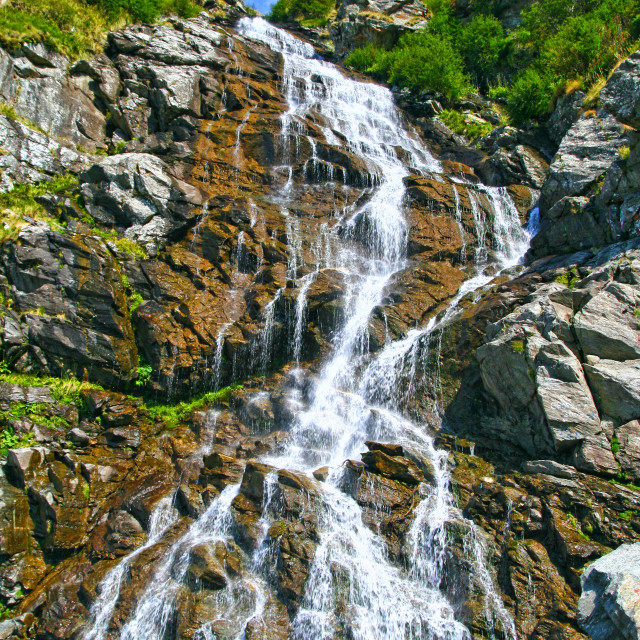 """""""Summer waterfall in a rocky mountain"""" stock image"""
