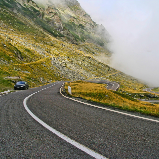 """""""Curvy mountain road in a rainy day"""" stock image"""