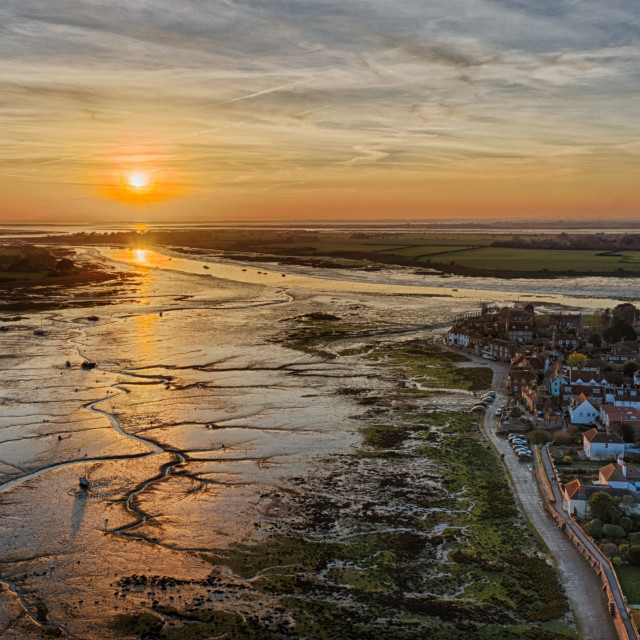 """The sun sets on Bosham Harbour in West Sussex. Bosham is the site where King Canute famously commanded the tide to go back."" stock image"