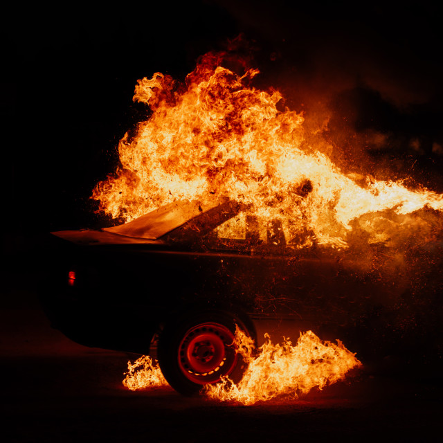 """""""political protests, burning cars on the street"""" stock image"""