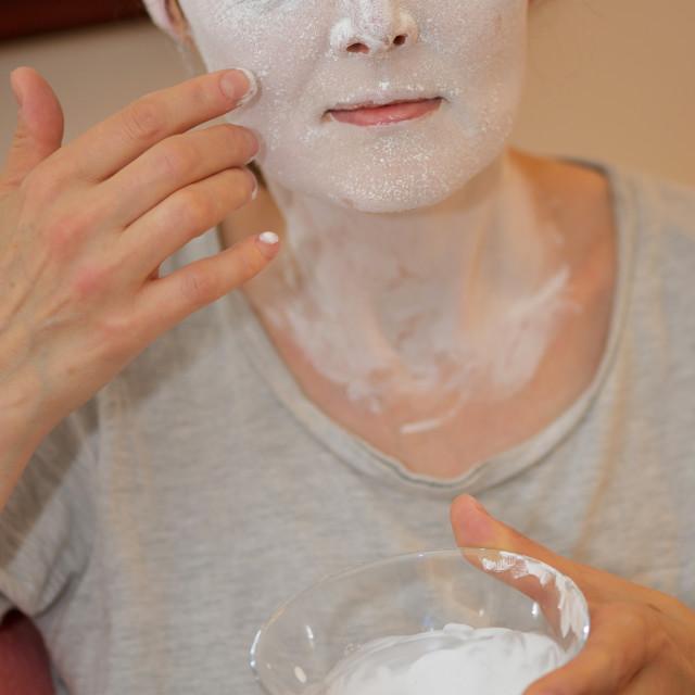 """Woman applying pearl powder mask"" stock image"