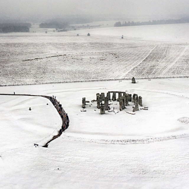 """Stonehenge is covered in snow"" stock image"