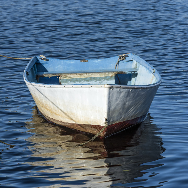 """Rowboat tethered at Rodman Crossing"" stock image"