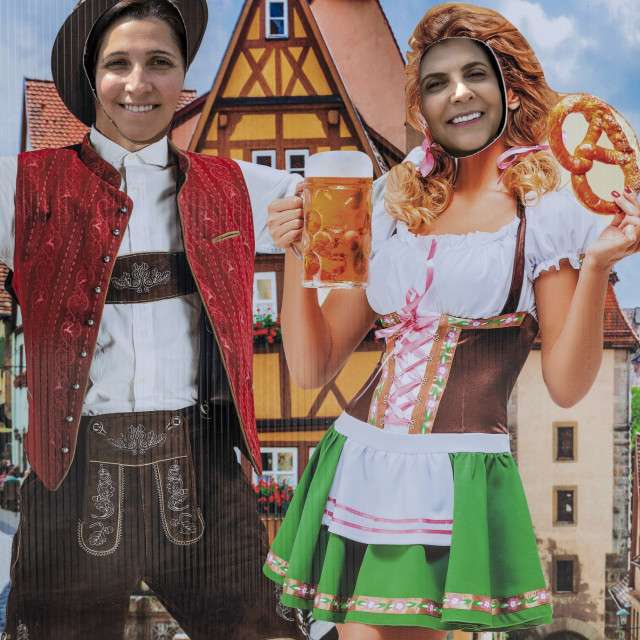 """Tourists pose in German Octoberfest motif cut-out, Helen, Georgia"" stock image"