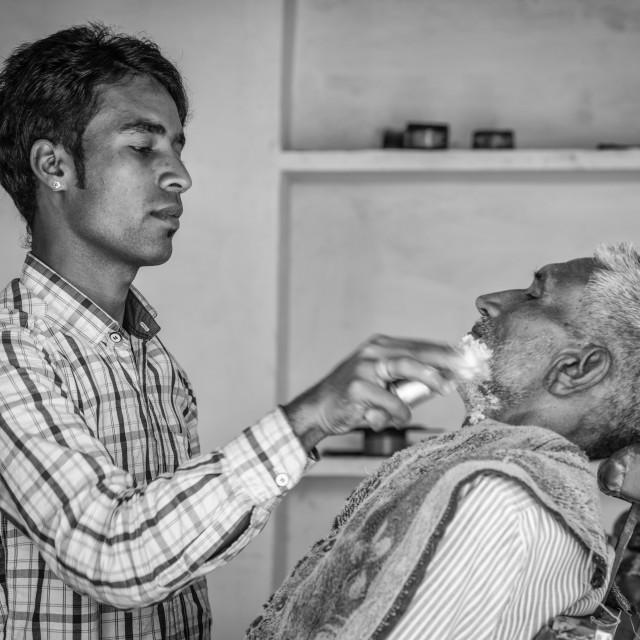 """""""Indian barber at work"""" stock image"""