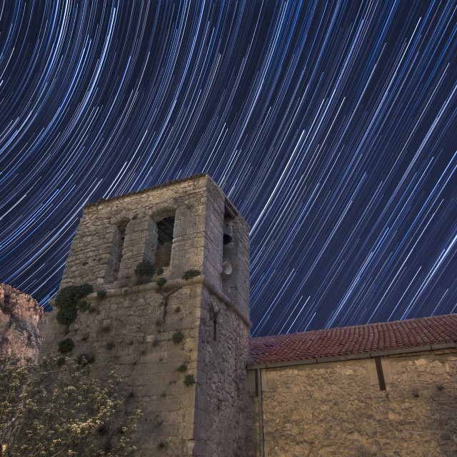 """Renaissance church bell tower in star trails"" stock image"