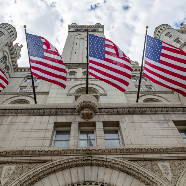 """""""View of US flags in front of former Old Post Office Pavilion, Washington DC"""" stock image"""