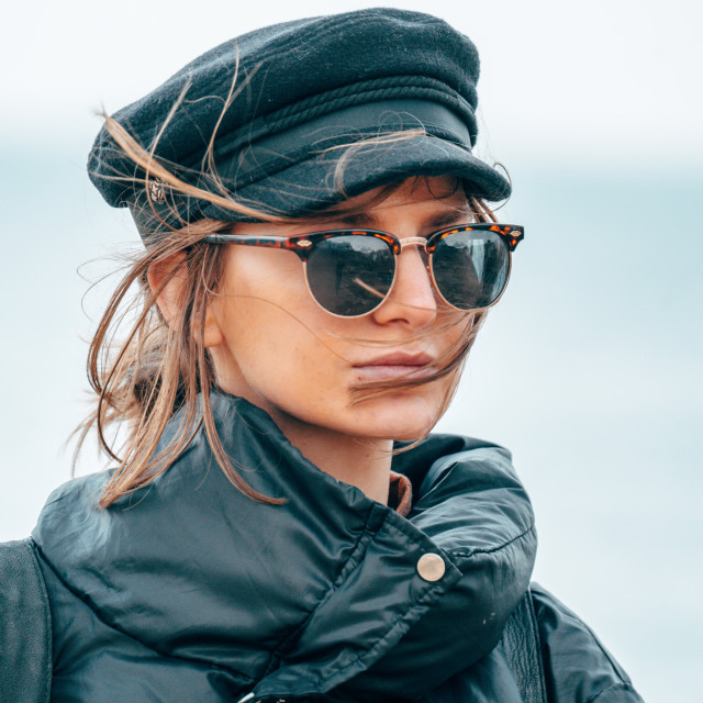 """""""Girl with glasses and jacker on a windy day in Italy"""" stock image"""
