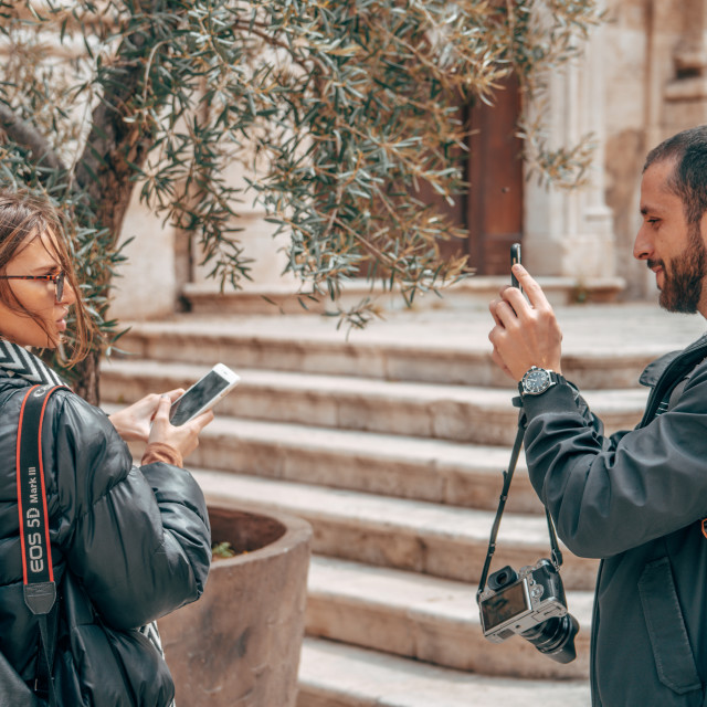 """""""Couple Taking Portraits on the streets of Lecce, Italy"""" stock image"""