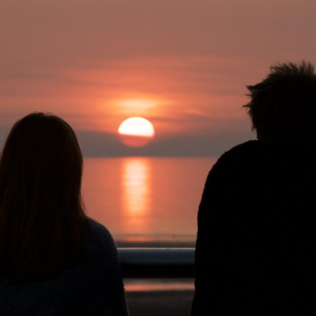 """Watching the sun set, Blackpool"" stock image"