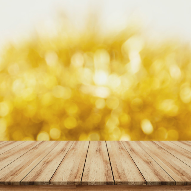 """Wooden tabletop for montage products display for festive sale promote with blurred gold background"" stock image"