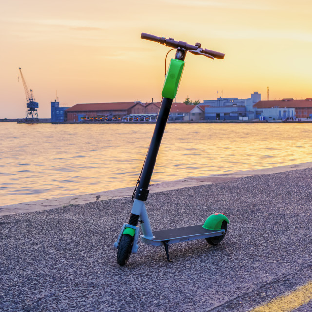 """""""Parked electric Scooter rental without passenger."""" stock image"""