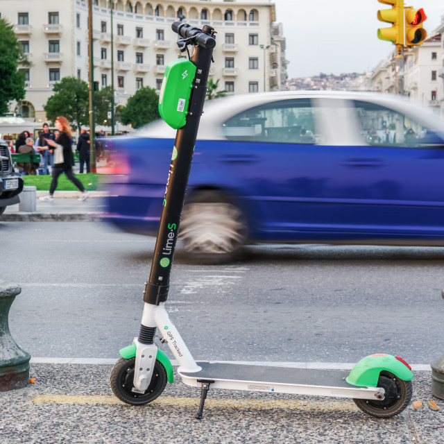 """""""Parked Lime electric Scooter rental without passenger."""" stock image"""