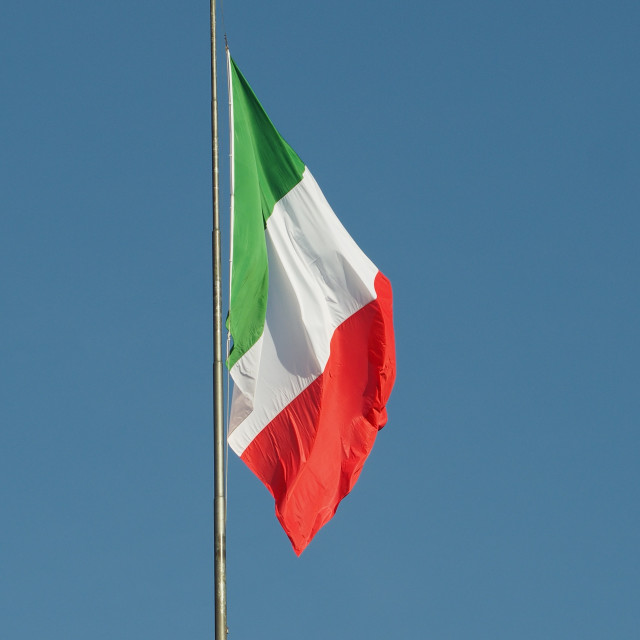 """Italian Flag of Italy over blue sky"" stock image"
