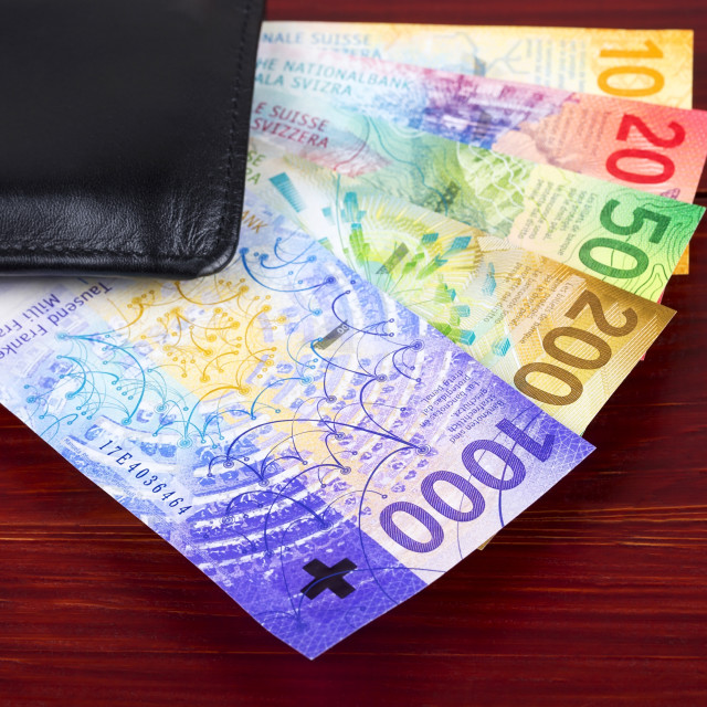 """""""New Swiss Francs in the black wallet"""" stock image"""