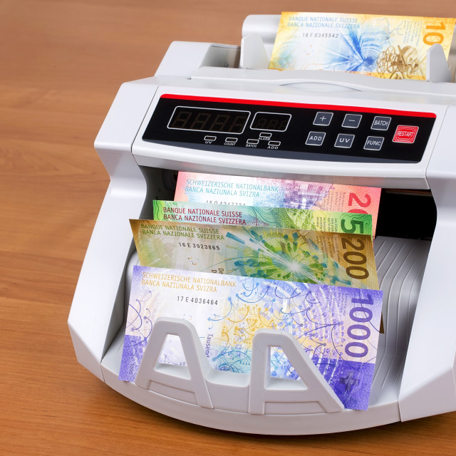 """""""New Swiss Francs in a counting machine"""" stock image"""