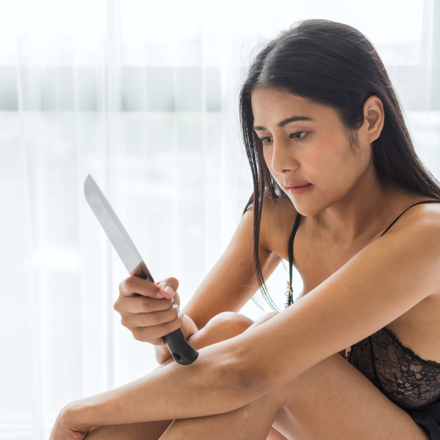 """Insane Asian woman with pajama hold knife"" stock image"