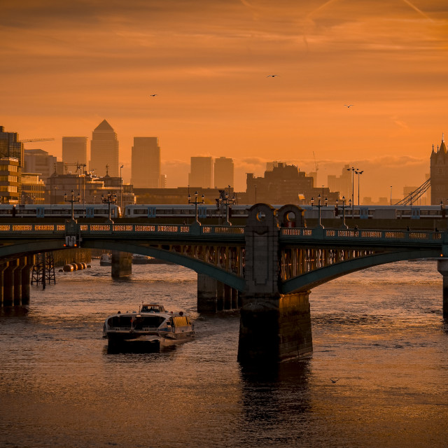 """Sunrise over The River Thames and Southwark Bridge"" stock image"