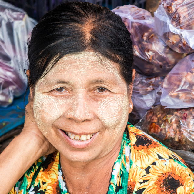 """Portrait of a smiling woman vendor"" stock image"
