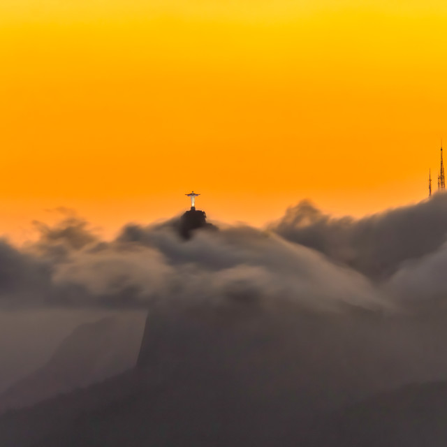 """Christ The Redeemer Against a Golden Sky"" stock image"