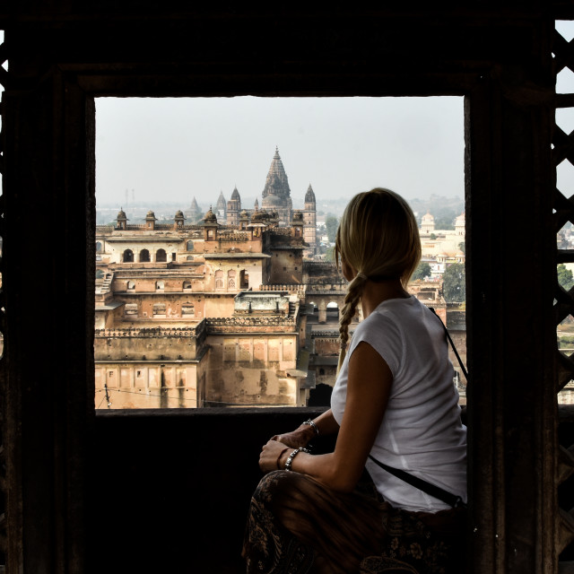 """blonde girl in Orchha watching medieval castles"" stock image"