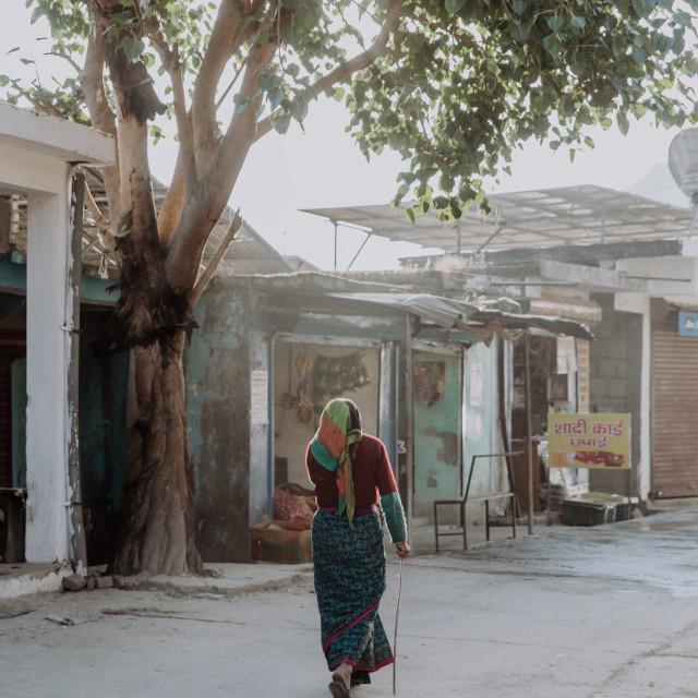 """""""Indian woman walking through her village"""" stock image"""