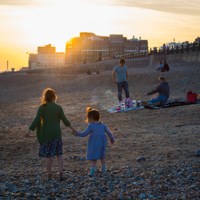 """Sunset and BBQs on Brighton Beach"" stock image"