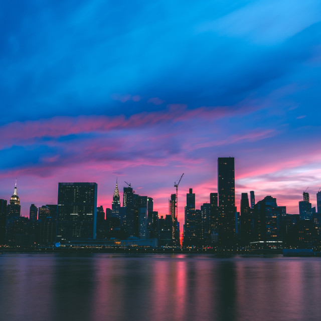 """""""New York City skyline silhouette during colorful sunset"""" stock image"""