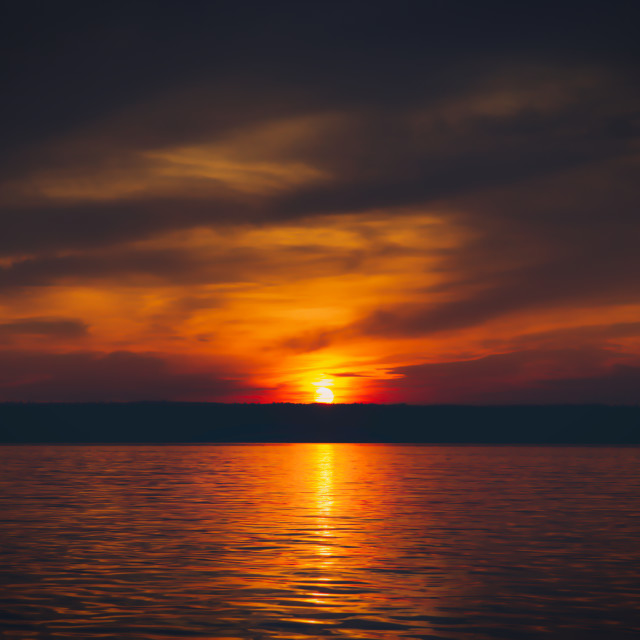 """""""A sunset over a lake"""" stock image"""